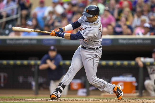 Aug 23, 2014; Minneapolis, MN, USA; Detroit Tigers first baseman Victor Martinez (41) hits a single in the second inning against the Minnesota Twins at Target Field. Mandatory Credit: Jesse Johnson-USA TODAY Sports