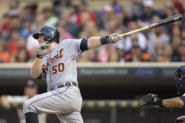 Aug 23, 2014; Minneapolis, MN, USA; Detroit Tigers catcher Bryan Holaday (50) hits a RBI single in the second inning against the Minnesota Twins at Target Field. Mandatory Credit: Jesse Johnson-USA TODAY Sports