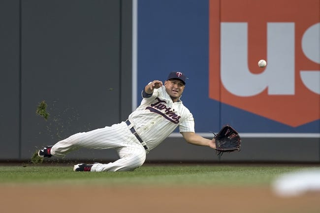 Aug 23, 2014; Minneapolis, MN, USA; Minnesota Twins right fielder Oswaldo Arcia (31) dives and attempts to catch a fly ball in the second inning against the Detroit Tigers at Target Field. Mandatory Credit: Jesse Johnson-USA TODAY Sports