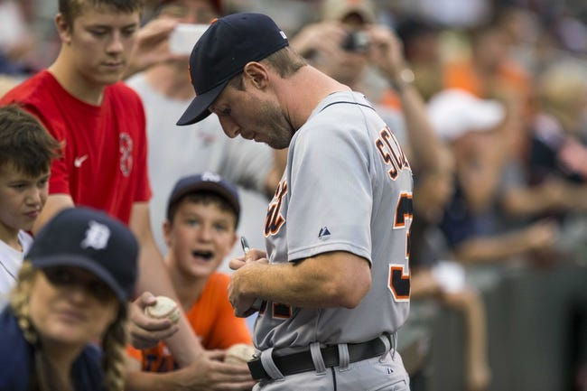 Aug 23, 2014; Minneapolis, MN, USA; Detroit Tigers starting pitcher Max Scherzer (37) signs autographs before a game against the Minnesota Twins at Target Field. Mandatory Credit: Jesse Johnson-USA TODAY Sports