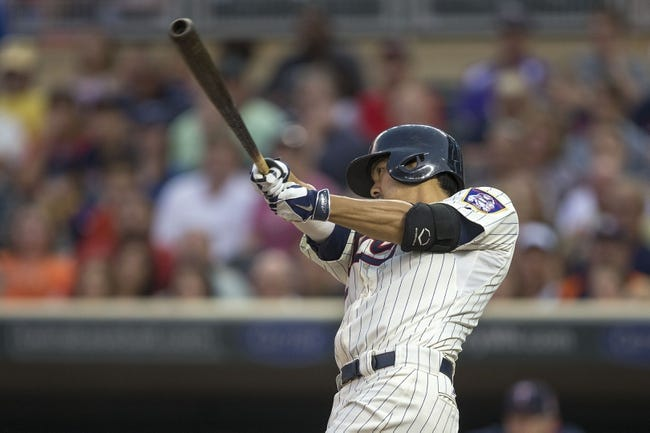 Aug 23, 2014; Minneapolis, MN, USA; Minnesota Twins catcher Kurt Suzuki (8) hits a RBI single in the second inning against the Detroit Tigers at Target Field. Mandatory Credit: Jesse Johnson-USA TODAY Sports
