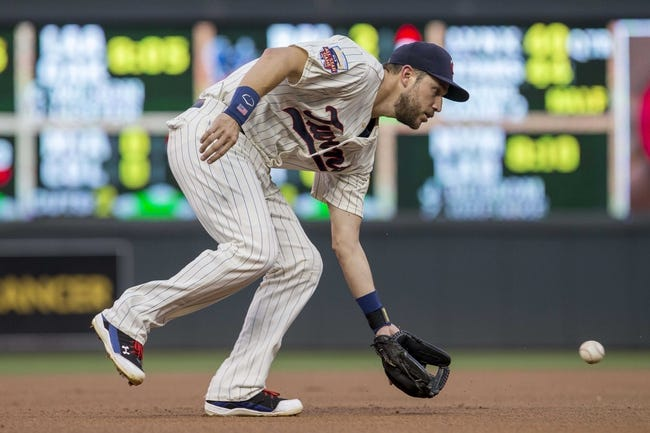 Aug 23, 2014; Minneapolis, MN, USA; Minnesota Twins third baseman Trevor Plouffe (24) fields a ground ball in the first inning against the Detroit Tigers at Target Field. Mandatory Credit: Jesse Johnson-USA TODAY Sports