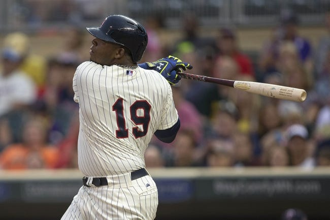 Aug 23, 2014; Minneapolis, MN, USA; Minnesota Twins designated hitter Kennys Vargas (19) hits a single in the second inning against the Detroit Tigers at Target Field. Mandatory Credit: Jesse Johnson-USA TODAY Sports