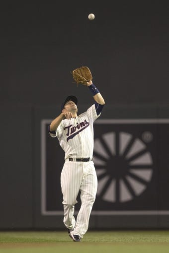 Aug 23, 2014; Minneapolis, MN, USA; Minnesota Twins second baseman Brian Dozier (2) catches a fly ball in the fourth inning against the Detroit Tigers at Target Field. Mandatory Credit: Jesse Johnson-USA TODAY Sports