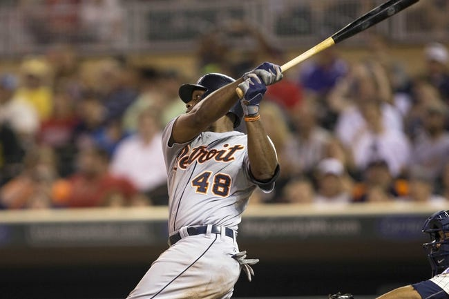 Aug 23, 2014; Minneapolis, MN, USA; Detroit Tigers right fielder Torii Hunter (48) hits a single in the fifth inning against the Minnesota Twins at Target Field. Mandatory Credit: Jesse Johnson-USA TODAY Sports