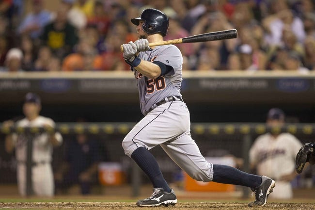 Aug 23, 2014; Minneapolis, MN, USA; Detroit Tigers catcher Bryan Holaday (50) hits a RBI double in the fifth inning against the Minnesota Twins at Target Field. Mandatory Credit: Jesse Johnson-USA TODAY Sports