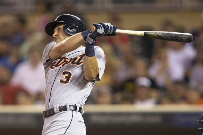 Aug 23, 2014; Minneapolis, MN, USA; Detroit Tigers second baseman Ian Kinsler (3) hits a single in the fifth inning against the Minnesota Twins at Target Field. Mandatory Credit: Jesse Johnson-USA TODAY Sports