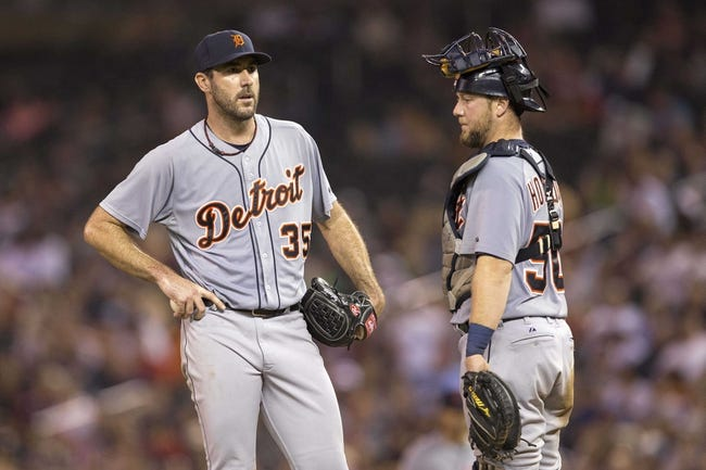 Aug 23, 2014; Minneapolis, MN, USA; Detroit Tigers starting pitcher Justin Verlander (35) looks on with catcher Bryan Holaday (50) during the sixth inning against the Minnesota Twins at Target Field. Mandatory Credit: Jesse Johnson-USA TODAY Sports