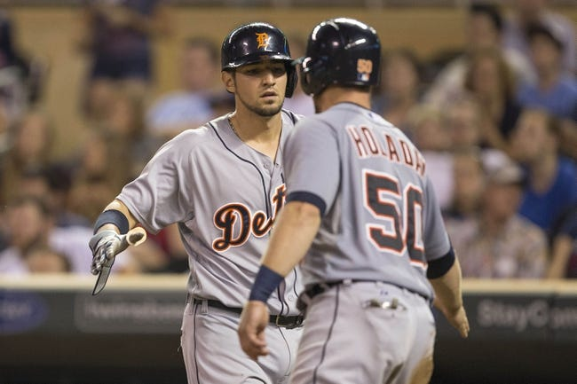 Aug 23, 2014; Minneapolis, MN, USA; Detroit Tigers third baseman Nick Castellanos (9) and catcher Bryan Holaday (50) celebrate after scoring runs in the fifth inning against the Minnesota Twins at Target Field. Mandatory Credit: Jesse Johnson-USA TODAY Sports