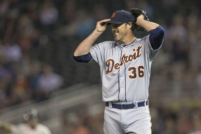 Aug 23, 2014; Minneapolis, MN, USA; Detroit Tigers relief pitcher Joe Nathan (36) reacts after giving up a run in the ninth inning against the Minnesota Twins at Target Field. The Tigers won 8-6. Mandatory Credit: Jesse Johnson-USA TODAY Sports