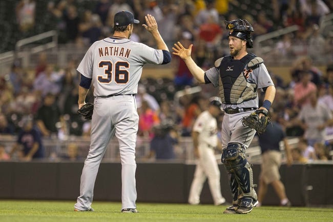 Aug 23, 2014; Minneapolis, MN, USA; Detroit Tigers relief pitcher Joe Nathan (36) celebrates with catcher Bryan Holaday (50) after beating the Minnesota Twins at Target Field. The Tigers won 8-6. Mandatory Credit: Jesse Johnson-USA TODAY Sports