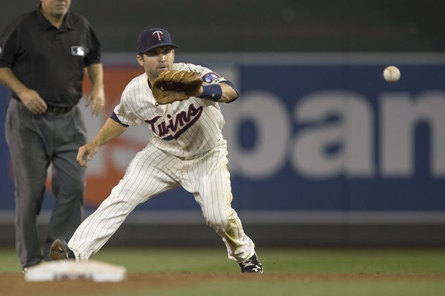 Aug 23, 2014; Minneapolis, MN, USA; Minnesota Twins second baseman Brian Dozier (2) fields a ground ball in the ninth inning against the Detroit Tigers at Target Field. The Tigers won 8-6. Mandatory Credit: Jesse Johnson-USA TODAY Sports