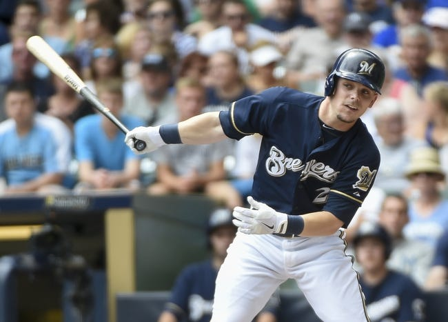 Aug 24, 2014; Milwaukee, WI, USA;   Milwaukee Brewers second baseman Scooter Gennett (2) hits a single to drive in a run in the first inning against the Pittsburgh Pirates at Miller Park. Mandatory Credit: Benny Sieu-USA TODAY Sports
