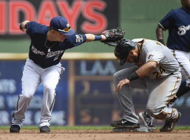 Aug 24, 2014; Milwaukee, WI, USA;   Pittsburgh Pirates first baseman Pedro Alvarez (24) steals second base as Milwaukee Brewers second baseman Scooter Gennett (2) puts on the late tag in the second inning at Miller Park. Mandatory Credit: Benny Sieu-USA TODAY Sports