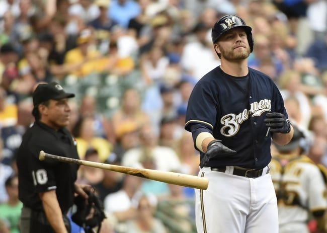 Aug 24, 2014; Milwaukee, WI, USA;   Milwaukee Brewers first baseman Mark Reynolds (7) reacts after striking out in the fifth inning against the Pittsburgh Pirates at Miller Park. Mandatory Credit: Benny Sieu-USA TODAY Sports