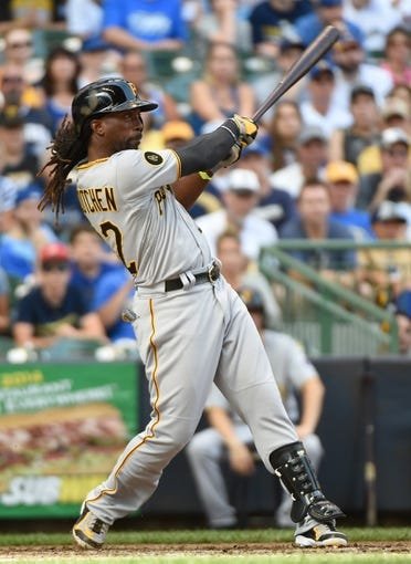 Aug 24, 2014; Milwaukee, WI, USA;  Pittsburgh Pirates center fielder Andrew McCutchen (22) hits a solo home run in the ninth inning against the Milwaukee Brewers at Miller Park. Mandatory Credit: Benny Sieu-USA TODAY Sports