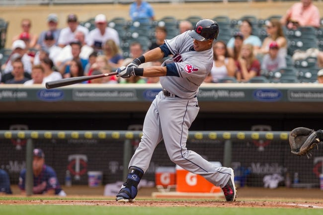 Aug 21, 2014; Minneapolis, MN, USA; Cleveland Indians left fielder Michael Brantley (23) at bat in the against the Minnesota Twins at Target Field. Mandatory Credit: Brad Rempel-USA TODAY Sports