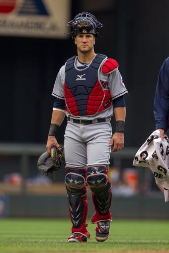 Aug 21, 2014; Minneapolis, MN, USA; Cleveland Indians catcher Yan Gomes (10) walks back to the dugout before the game in the against the Minnesota Twins at Target Field. Mandatory Credit: Brad Rempel-USA TODAY Sports