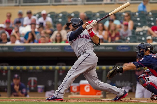 Aug 21, 2014; Minneapolis, MN, USA; Cleveland Indians shortstop Mike Aviles (4) at bat in the against the Minnesota Twins at Target Field. Mandatory Credit: Brad Rempel-USA TODAY Sports