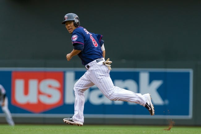 Aug 21, 2014; Minneapolis, MN, USA; Minnesota Twins catcher Kurt Suzuki (8) runs to second in the against the Cleveland Indians at Target Field. Mandatory Credit: Brad Rempel-USA TODAY Sports