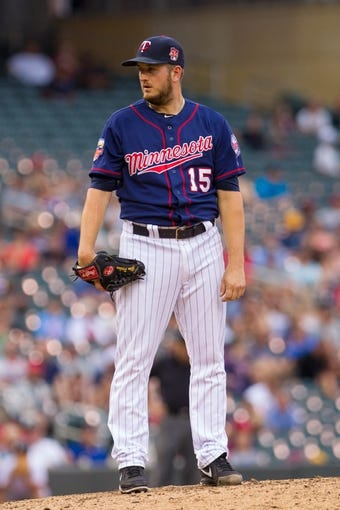 Aug 21, 2014; Minneapolis, MN, USA; Minnesota Twins relief pitcher Glen Perkins (15) on the mound in the against the Cleveland Indians at Target Field. Mandatory Credit: Brad Rempel-USA TODAY Sports