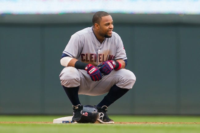 Aug 21, 2014; Minneapolis, MN, USA; Cleveland Indians first baseman Carlos Santana (41) waits for the video replay at second base in the against the Minnesota Twins at Target Field. Mandatory Credit: Brad Rempel-USA TODAY Sports