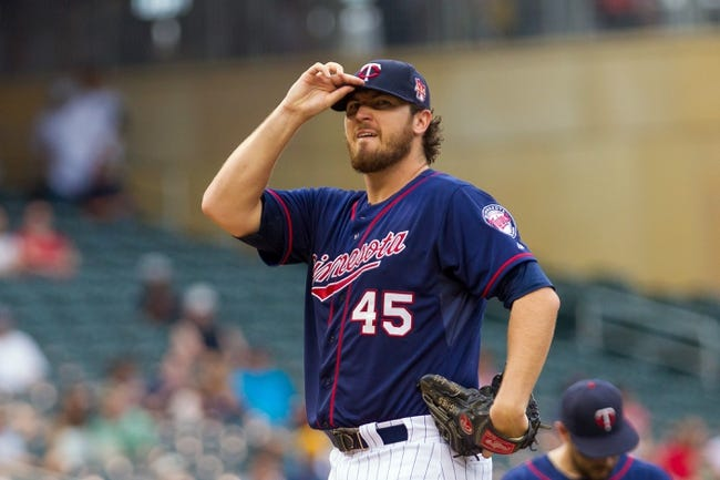 Aug 21, 2014; Minneapolis, MN, USA; Minnesota Twins starting pitcher Phil Hughes (45) on the mound in the against the Cleveland Indians at Target Field. Mandatory Credit: Brad Rempel-USA TODAY Sports