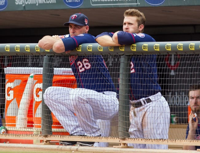 Aug 21, 2014; Minneapolis, MN, USA; Minnesota Twins catcher Eric Fryer (26) and second baseman Brian Dozier (2) in the dugout in the against the Cleveland Indians at Target Field. Mandatory Credit: Brad Rempel-USA TODAY Sports