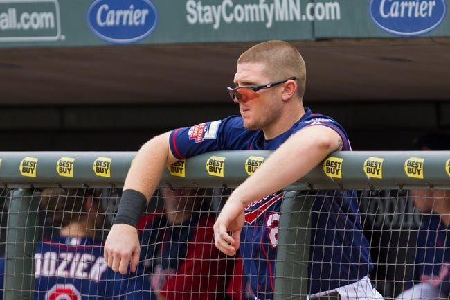 Aug 21, 2014; Minneapolis, MN, USA; Minnesota Twins left fielder Chris Parmelee (27) in the dugout in the against the Cleveland Indians at Target Field. Mandatory Credit: Brad Rempel-USA TODAY Sports