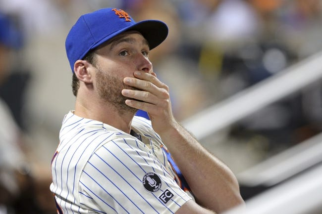 Aug 26, 2014; New York, NY, USA; New York Mets second baseman Daniel Murphy (28) looks on from the dugout during the third inning of a game against the Atlanta Braves at Citi Field. Mandatory Credit: Brad Penner-USA TODAY Sports