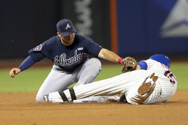 Aug 26, 2014; New York, NY, USA; New York Mets catcher Travis d'Arnaud (15) slides safely into second with a double ahead of a tag by Atlanta Braves second baseman Tommy La Stella (7) during the fourth inning of a game at Citi Field. Mandatory Credit: Brad Penner-USA TODAY Sports