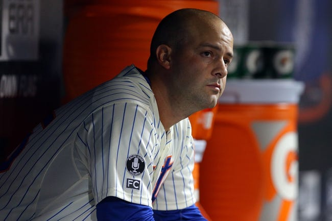 Aug 26, 2014; New York, NY, USA; New York Mets starting pitcher Dillon Gee (35) reacts in the dugout after being removed from the game during the seventh inning of a game against the Atlanta Braves at Citi Field. The Mets defeated the Braves 3-2. Mandatory Credit: Brad Penner-USA TODAY Sports