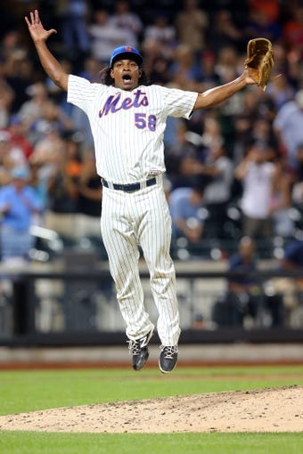 Aug 26, 2014; New York, NY, USA; New York Mets relief pitcher Jenrry Mejia (58) reacts after closing the game against the Atlanta Braves at Citi Field. The Mets defeated the Braves 3-2. Mandatory Credit: Brad Penner-USA TODAY Sports