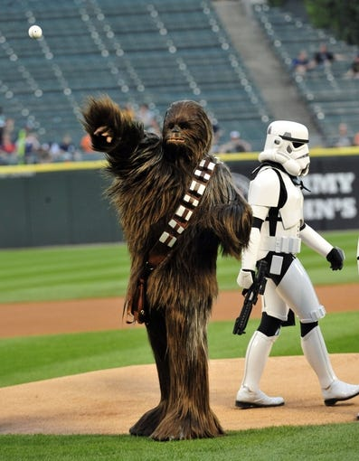 Aug 29, 2014; Chicago, IL, USA; A person dressed as Chewbacca throws out the ceremonial first pitch before the game between the Chicago White Sox and the Detroit Tigers at U.S Cellular Field. Mandatory Credit: David Banks-USA TODAY Sports