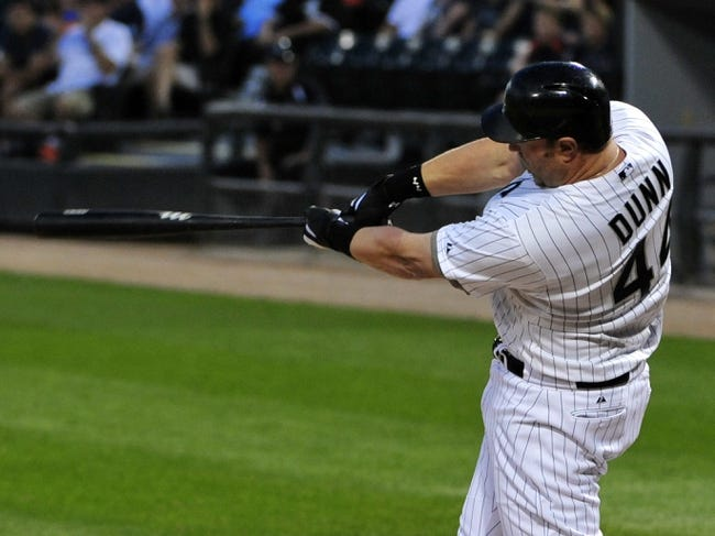 Aug 29, 2014; Chicago, IL, USA;  Chicago White Sox designated hitter Adam Dunn (44) hits an RBI sacrifice against the Detroit Tigers during the first inning at U.S Cellular Field. Mandatory Credit: David Banks-USA TODAY Sports