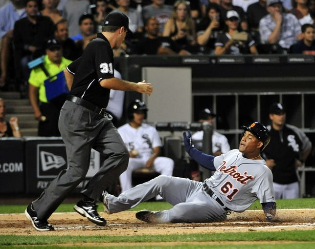 Aug 29, 2014; Chicago, IL, USA; Detroit Tigers center fielder Ezequiel Carrera (61) scores against the Chicago White Sox during the third inning at U.S Cellular Field. Mandatory Credit: David Banks-USA TODAY Sports