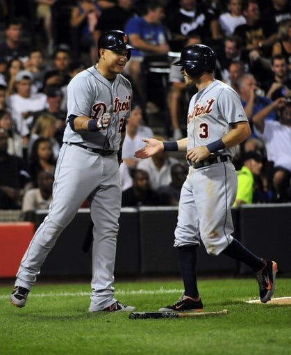 Aug 29, 2014; Chicago, IL, USA; Detroit Tigers second baseman Ian Kinsler (3) is greeted after scoring by first baseman Miguel Cabrera (24) against the Chicago White Sox during the third inning at U.S Cellular Field. Mandatory Credit: David Banks-USA TODAY Sports
