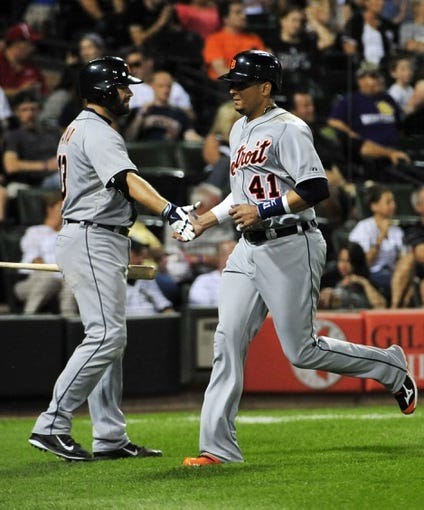 Aug 29, 2014; Chicago, IL, USA;  Detroit Tigers designated hitter Victor Martinez (41) is greeted by catcher Alex Avila (13) after scoring against the Chicago White Sox during the fourth inning at U.S Cellular Field. Mandatory Credit: David Banks-USA TODAY Sports