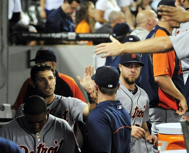Aug 29, 2014; Chicago, IL, USA; Detroit Tigers second baseman Ian Kinsler (3) is greeted after scoring against the Chicago White Sox during the fourth inning at U.S Cellular Field. Mandatory Credit: David Banks-USA TODAY Sports