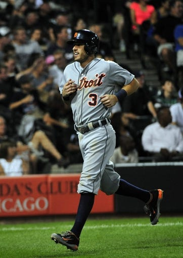 Aug 29, 2014; Chicago, IL, USA; Detroit Tigers second baseman Ian Kinsler (3) scores against the Chicago White Sox during the fourth inning at U.S Cellular Field. Mandatory Credit: David Banks-USA TODAY Sports