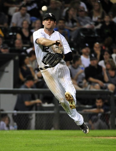 Aug 29, 2014; Chicago, IL, USA; Chicago White Sox third baseman Conor Gillaspie (12) makes a play on Detroit Tigers left fielder J.D. Martinez (not pictured) during the seventh inning at U.S Cellular Field. Mandatory Credit: David Banks-USA TODAY Sports