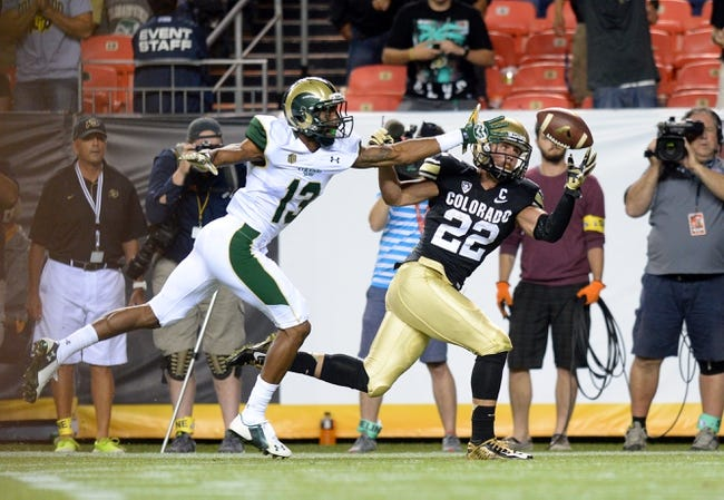Aug 29, 2014; Denver, CO, USA; Colorado Buffaloes wide receiver Nelson Spruce (22) pulls in his second touchdown of the game during the third quarter as Colorado State Rams defensive back DeAndre Elliott (13) defends at Sports Authority Field at Mile High. The Rams defeated the Buffaloes 31-17. Mandatory Credit: Ron Chenoy-USA TODAY Sports