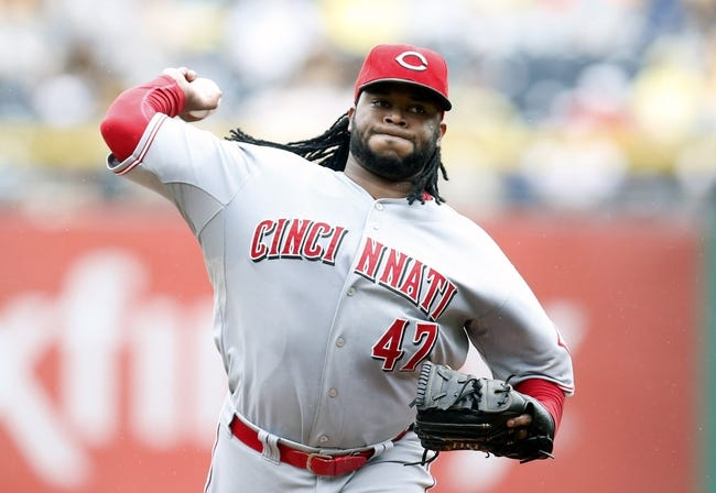 Aug 31, 2014; Pittsburgh, PA, USA; Cincinnati Reds starting pitcher Johnny Cueto (47) pitches against the Pittsburgh Pirates during the second inning at PNC Park. Mandatory Credit: Charles LeClaire-USA TODAY Sports