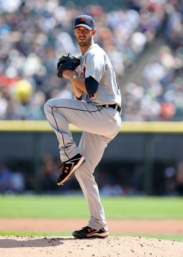 Aug 31, 2014; Chicago, IL, USA; Detroit Tigers starting pitcher Rick Porcello throws a pitch against the Chicago White Sox during the first inning at U.S Cellular Field. Mandatory Credit: Jerry Lai-USA TODAY Sports
