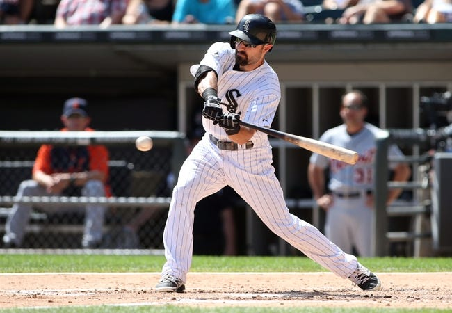 Aug 31, 2014; Chicago, IL, USA; Chicago White Sox center fielder Adam Eaton hits a double against the Detroit Tigers during the second inning at U.S Cellular Field. Mandatory Credit: Jerry Lai-USA TODAY Sports