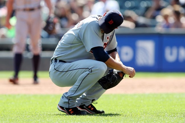 Aug 31, 2014; Chicago, IL, USA; Detroit Tigers starting pitcher Rick Porcello reacts after giving up three runs to the Chicago White Sox during the second inning at U.S Cellular Field. Mandatory Credit: Jerry Lai-USA TODAY Sports