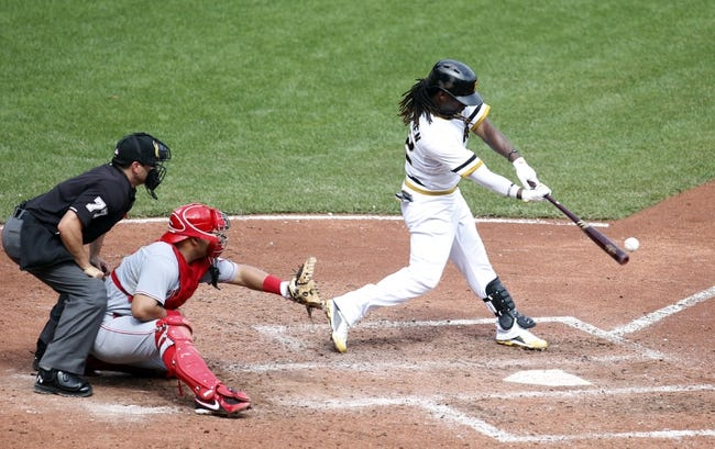 Aug 31, 2014; Pittsburgh, PA, USA; Pittsburgh Pirates center fielder Andrew McCutchen (22) singles against the Cincinnati Reds during the sixth inning at PNC Park. The Reds won 3-2. Mandatory Credit: Charles LeClaire-USA TODAY Sports