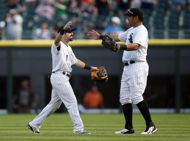 Aug 31, 2014; Chicago, IL, USA; Chicago White Sox center fielder Adam Eaton (1) celebrates with right fielder Avisail Garcia (right) after the game against the Detroit Tigers at U.S Cellular Field. Mandatory Credit: Jerry Lai-USA TODAY Sports