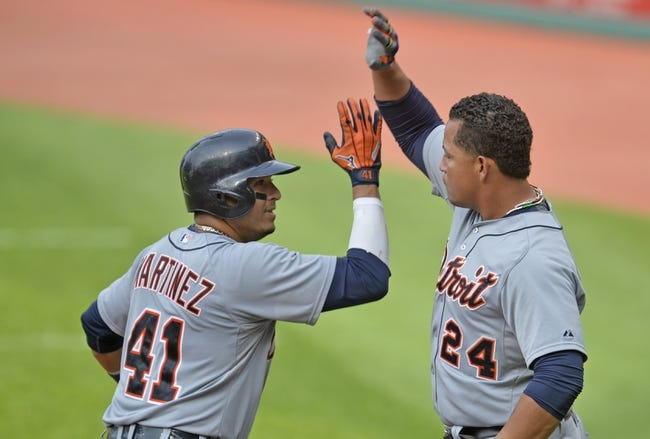 Sep 1, 2014; Cleveland, OH, USA; Detroit Tigers first baseman Victor Martinez (41) celebrates his two-run home run with designated hitter Miguel Cabrera (24) in the third inning against the Cleveland Indians at Progressive Field. Mandatory Credit: David Richard-USA TODAY Sports