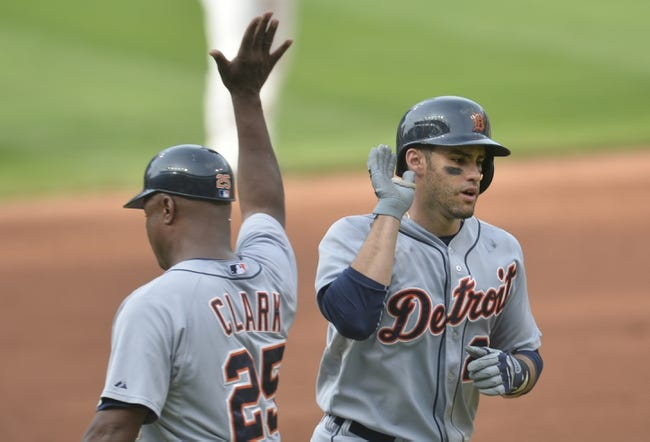 Sep 1, 2014; Cleveland, OH, USA; Detroit Tigers left fielder J.D. Martinez (28) celebrates with third base coach Dave Clark (25) after hitting a solo home run in the third inning against the Cleveland Indians at Progressive Field. Mandatory Credit: David Richard-USA TODAY Sports